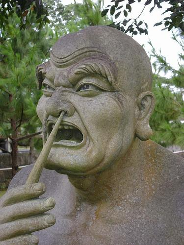 A statue of a man picking his nose - flickr - therealbrute