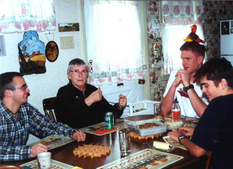 Grandma Marion Manelius with Rick, Dan, and Rob