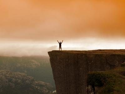 Man standing by a cliff