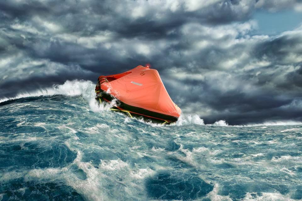 Life raft in turbulent ocean waters.