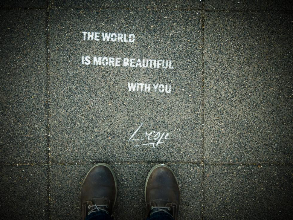 Quote written on the pavement.