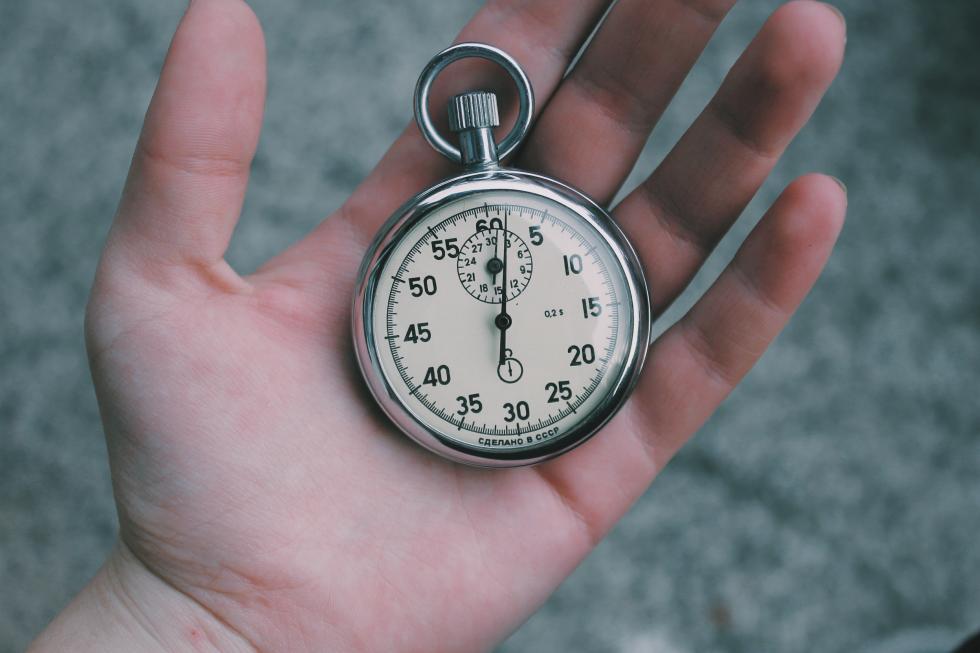 Stopwatch held in hand.