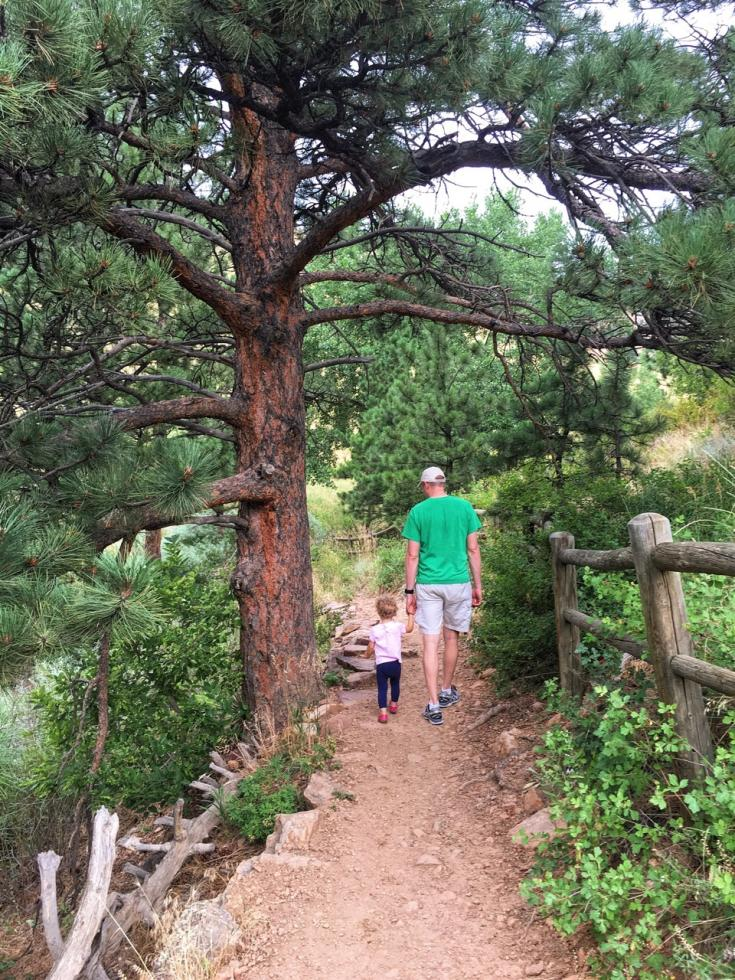 Rick and Evelyn holding handles while walking up a trail on Mount Sanitas.